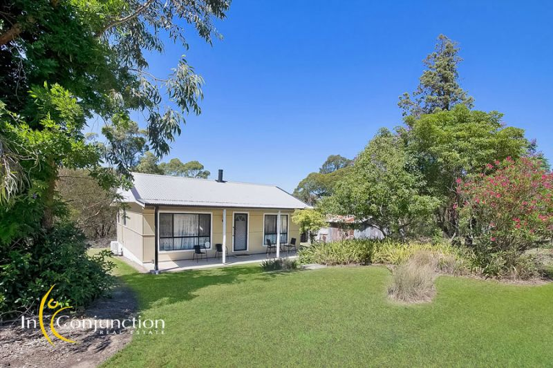 Fabulous location - walking distance to Glenorie village. Perfect blank canvas with attractive 2 bedroom cottage on 5 acres.