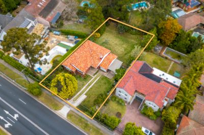Single level brick house on 1,024sqm land with architectural plans ready to extend.