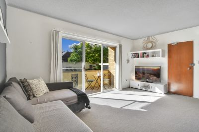 North Facing Apartment with Prized Lock-Up Garage