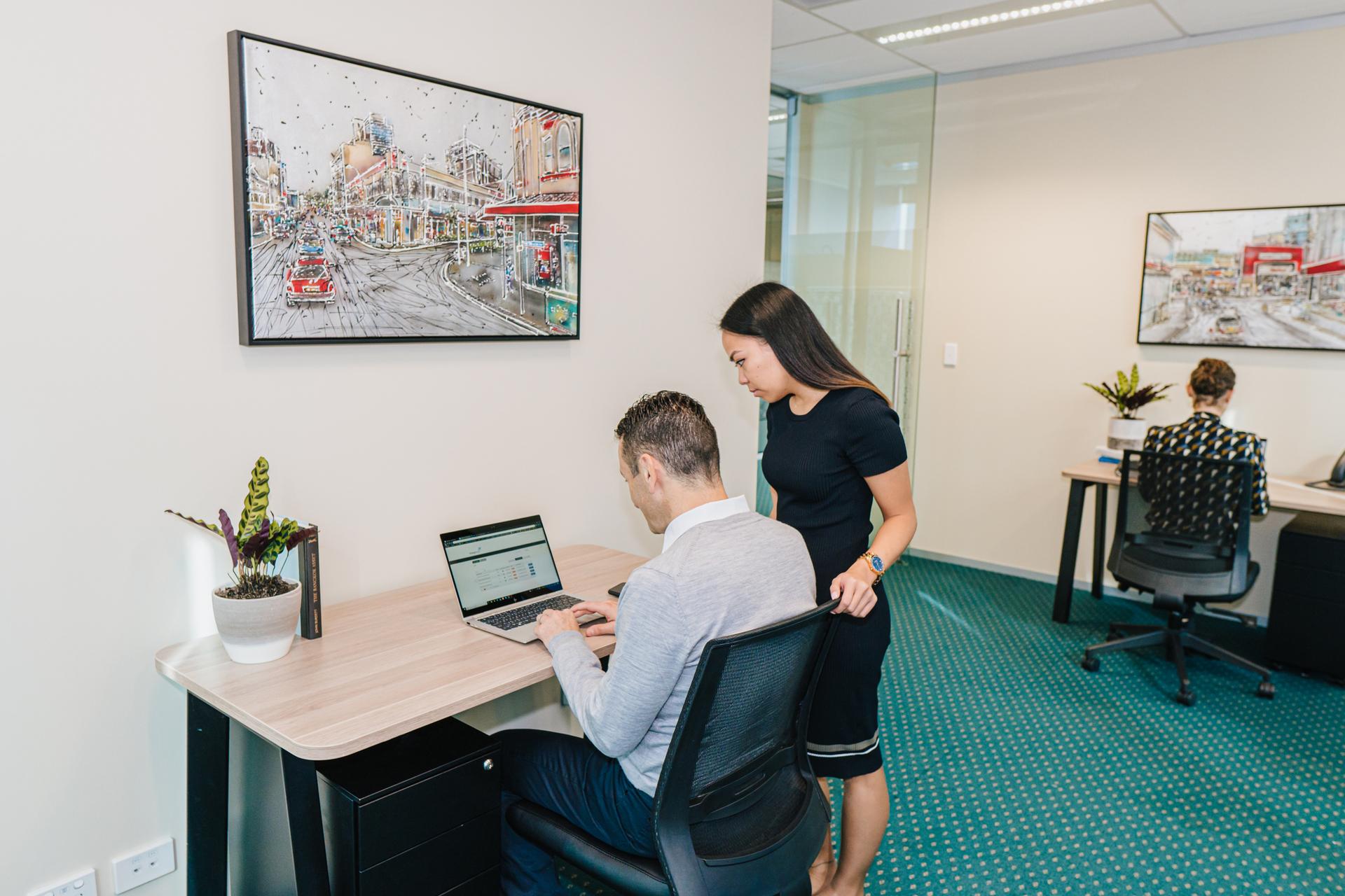 Collaborative 6-person workspace with views over the Parramatta CBD