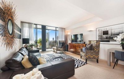 EXECUTIVE TWO BEDROOM SUB-PENTHOUSE IN THE LANDMARK 'MONUMENT' COMPLEX