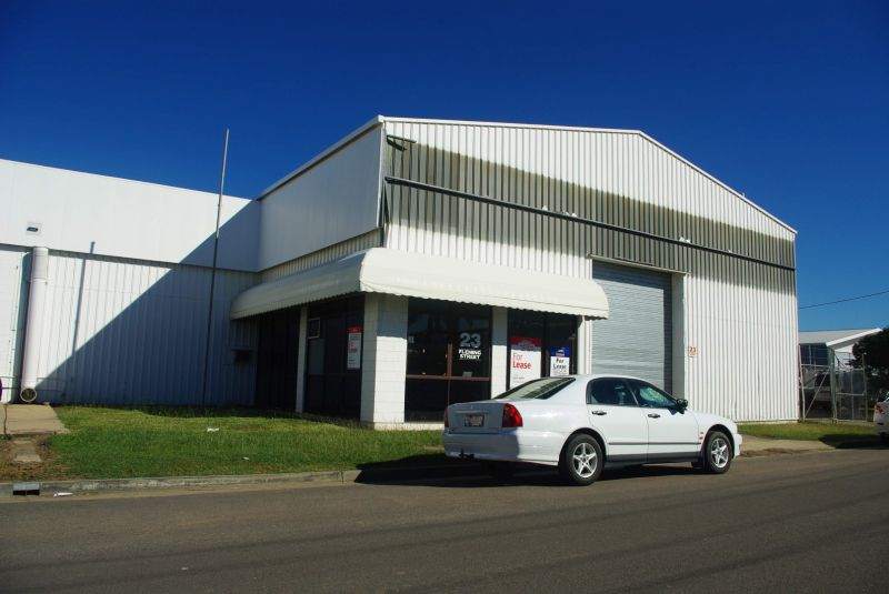 Freehold warehouse complex with holding income