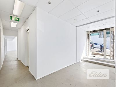 MODERN TURNKEY OFFICE/SHOWROOM WITH 3 CARS!