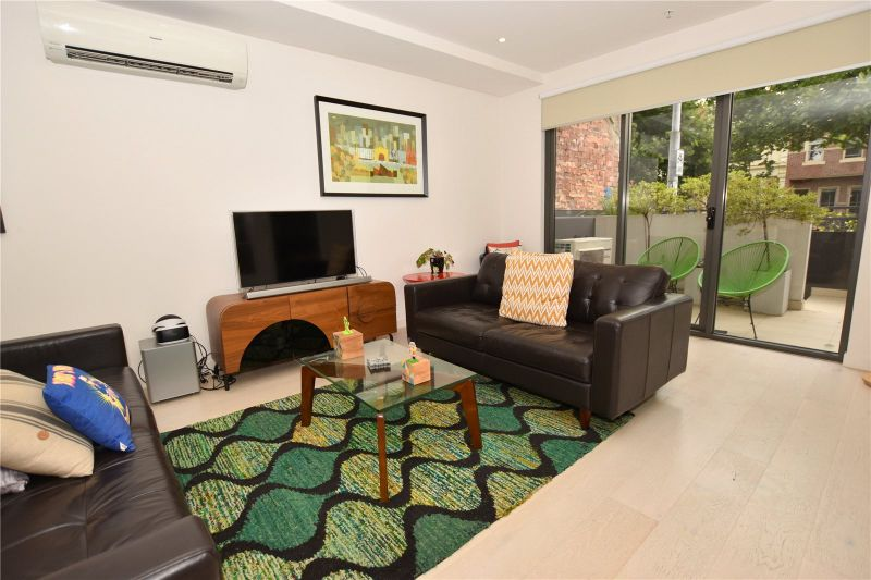 Fantastic Apartment in Heart of North Melbourne with Two Courtyards!