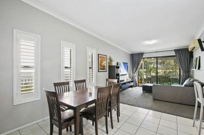 Immaculate golf front duplex in gated estate