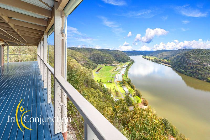 Location, Location! Breathtaking Hawkesbury River views. Expansive timber decks. This property definitely has the wow factor!