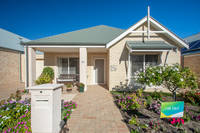 Delightful three-bedroom villa priced to sell. Relax in your private garden on a sunny afternoon.