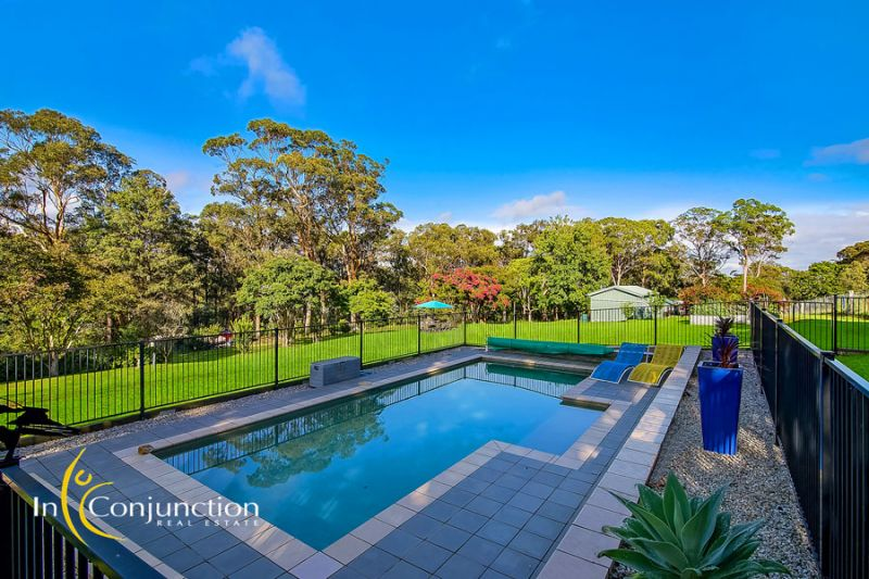 Lovely acreage block with immaculately presented 5 bedroom home- walk to Glenorie village, local school and transport.