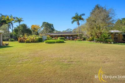 bring the in-laws! two homes on 5 lovely acres with picturesque dams, shed, stunning gardens, views and trails. pure delight!
