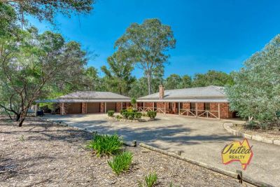 Acreage & Family Oasis in Flourishing Rossmore!