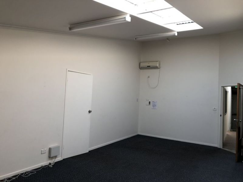 High clearance warehouse with office and rear yard...