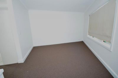 Conveniently Located 2 Bedroom Unit; Freshly Painted & Carpeted
