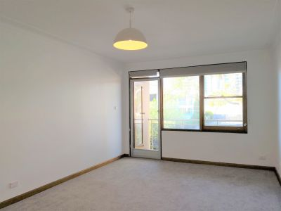 Updated Unit in Easy Living Location!