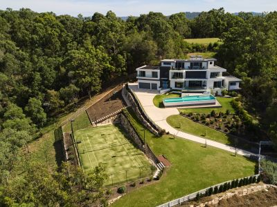 TRI-LEVEL DESIGN STATEMENT WITH COASTLINE VIEWS IN EXCLUSIVE JABIRU ESTATE