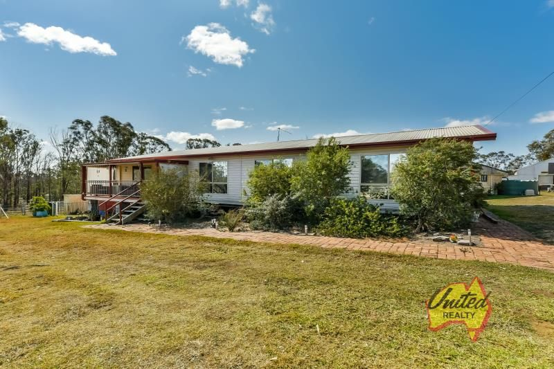 APPROX. 5 ACRES WITH PLENTY OF STORAGE - SUITABLE FOR HORSES