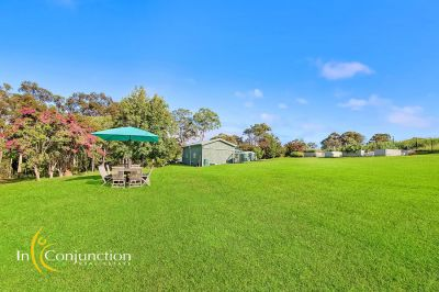 inspection by appointment. lovely acreage block with immaculately presented 5 bedroom home- walk to glenorie village, local school and transport.