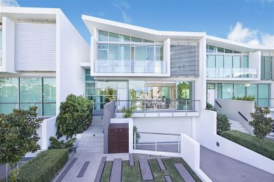 LAST ONE LEFT WITH PRIVATE BROADWATER VIEWS - STUNNING 3-LEVEL VILLA
