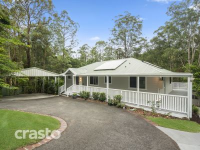 Character Queenslander Style Home in a Tranquil Acreage Setting with a Pool and Large Shed.