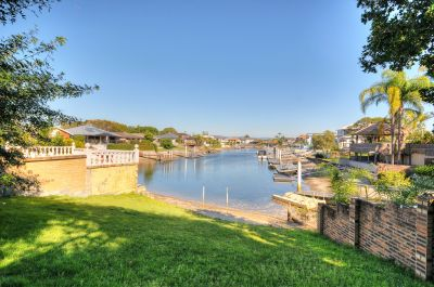 Neat waterfront home with huge open plan living