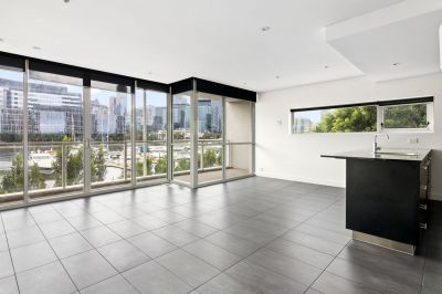 2 bedroom podium waterside apartment with sunset views.