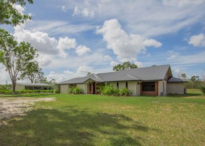 STUNNING HOME ON 5 ACRES WITH 8 BAYS OF SHED SPACE + DOUBLE GARAGE, TOWN WATER + SUBDIVISION POTENTIAL…..