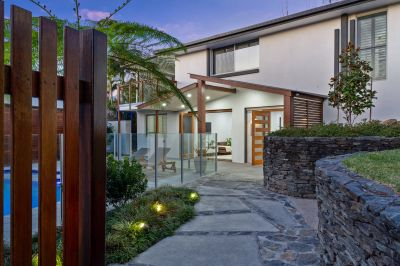 Elevated Family Entertainer with Dual Living Potential