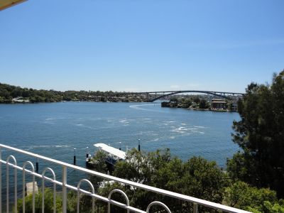 TOP FLOOR WATERFRONT UNIT WITH VIEWS