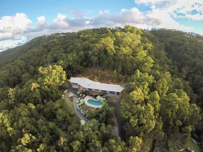 70 square Dual-Living Retreat with Ocean & Hinterland Views in Absolute Privacy on over 9 acres - Huge Potential to Transform & Capitalise!