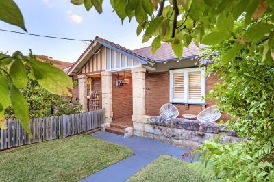 An Enchanting Bayside Cottage with Idyllic Gardens