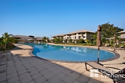 Second floor end unit with large balcony - river and pool views