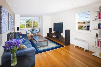 Superb Luxury Beachside apartment offers Views, Parking + Ideal Beachside location.