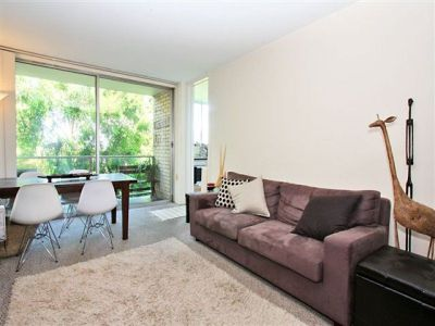 CITY SKYLINE VIEWS. RECENTLY UPDATED. LARGE OPEN PLAN LIVING FLOWING TO BALCONY. PARKING!