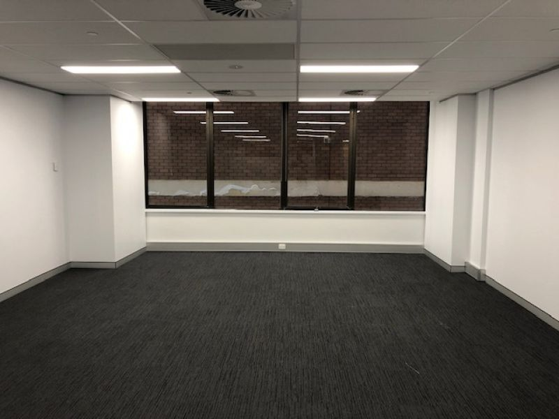 83m2 CBD Modern Partitioned Office New Carpet & New Painting
