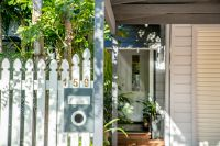 Smartly Updated Character Home Amid Garden Paradise