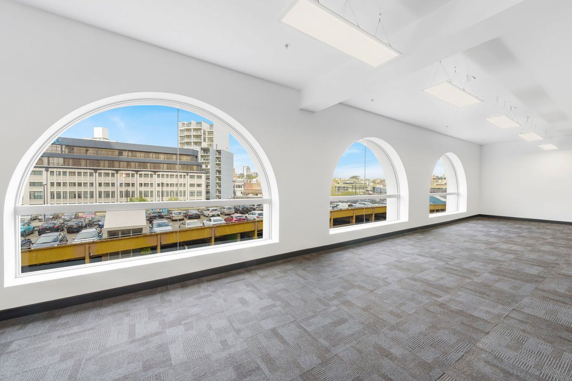 Arched windows and exposed ceilings