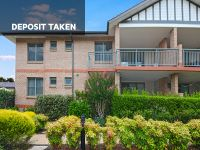 DEPOSIT TAKEN North-facing living areas and balcony with garden outlook