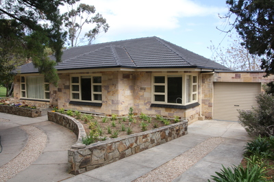 Quality built home with external walls of Point Tucked Basket Range Stone.