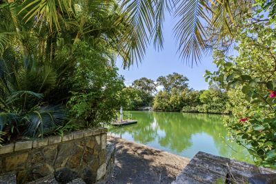 MUST BE SOLD - YOU BENEFIT HERE - Absolute Waterfront Hidden Sanctuary in Florida Gardens