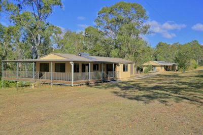 A RETREAT FOR TWO FAMILIES ON 5 ACRES! A MUST SEE PROPERTY!