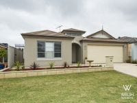 QUALITY HOME WITH LOW MAINTENANCE GARDENS