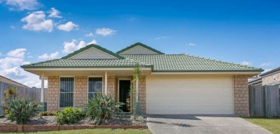 IMMACULATE BRICK HOME WITH LOW MAINTENANCE YARD