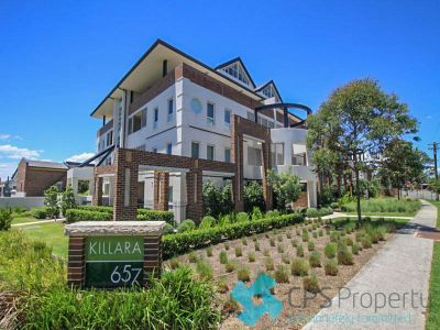 EAST FACING OPEN PLAN GARDEN APARTMENT IN LANDMARK COMPLEX