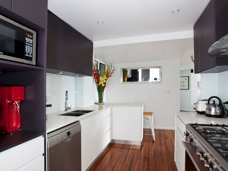 RENOVATED DESIGNER APARTMENT WITH PARKING AND STORAGE