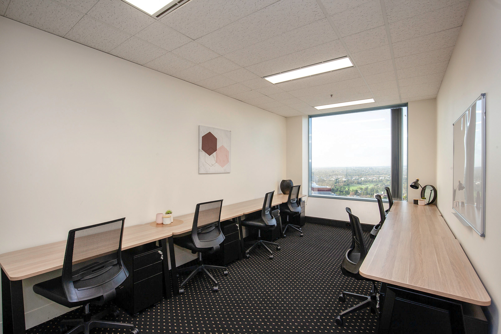 8-person collaborative workspace with outstanding views across Adelaide's skyline