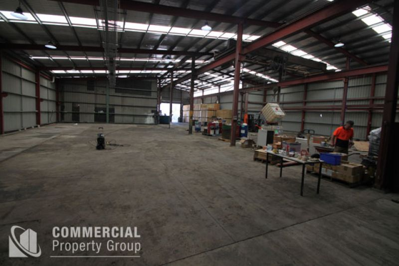 LEASED BY MATTHEW MCHARDY - STREET FRONTING - WITH FRONT AND REAR ROLLER DOORS