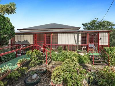 SPACIOUS FAMILY HOME ON OVER ½ ACRE WITH SHEDS!