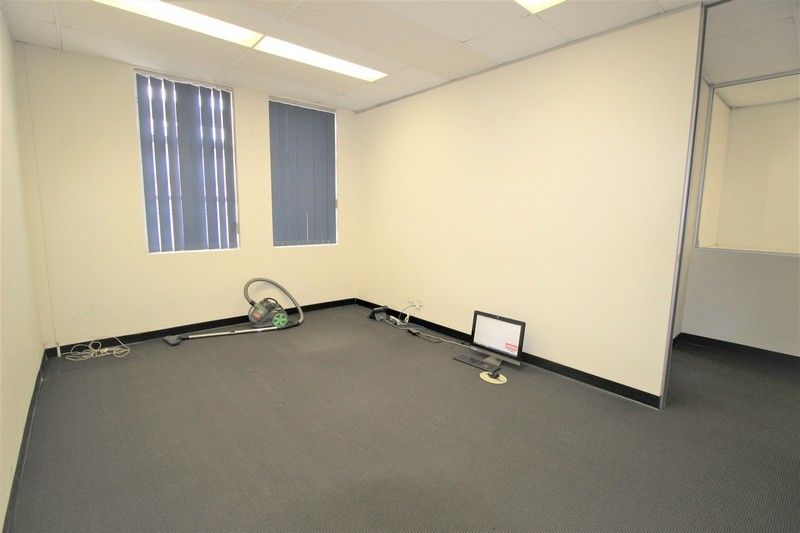 TWO FIRST FLOOR OFFICES RIGHT NEXT TO TRAIN STATION!