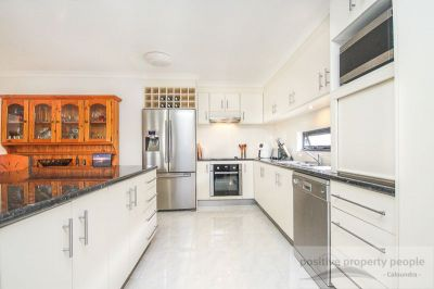 Separate Media Room, Huge Family Kitchen!