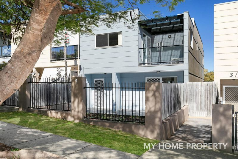 FANTASTIC TRI LEVEL TOWNHOME THIS PROPERTY CANT BE MISSED