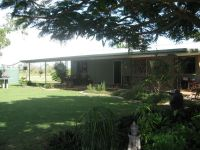 100 ACRES / BLOCK HOME / SHEDS